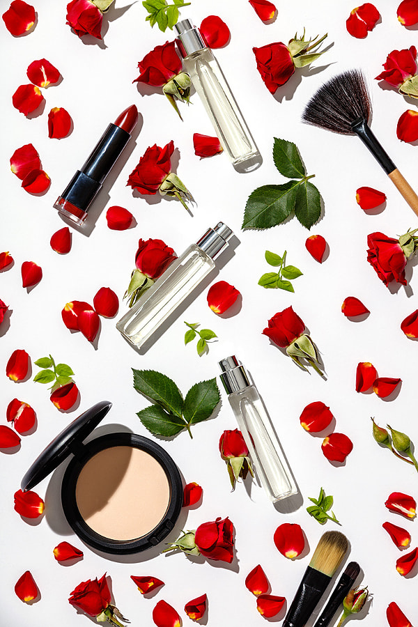 Bottles of woman perfume with cosmetic products and red roses on by Natalia Klenova on 500px.com