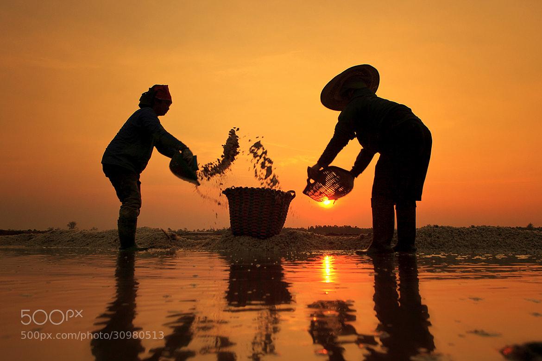 Photograph Salt farmer by Saravut Whanset on 500px