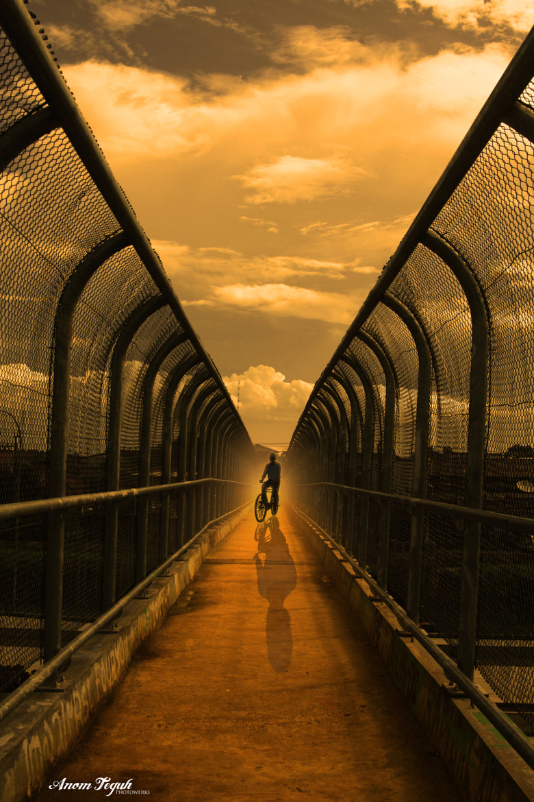 Photograph in the middle by anom himura on 500px