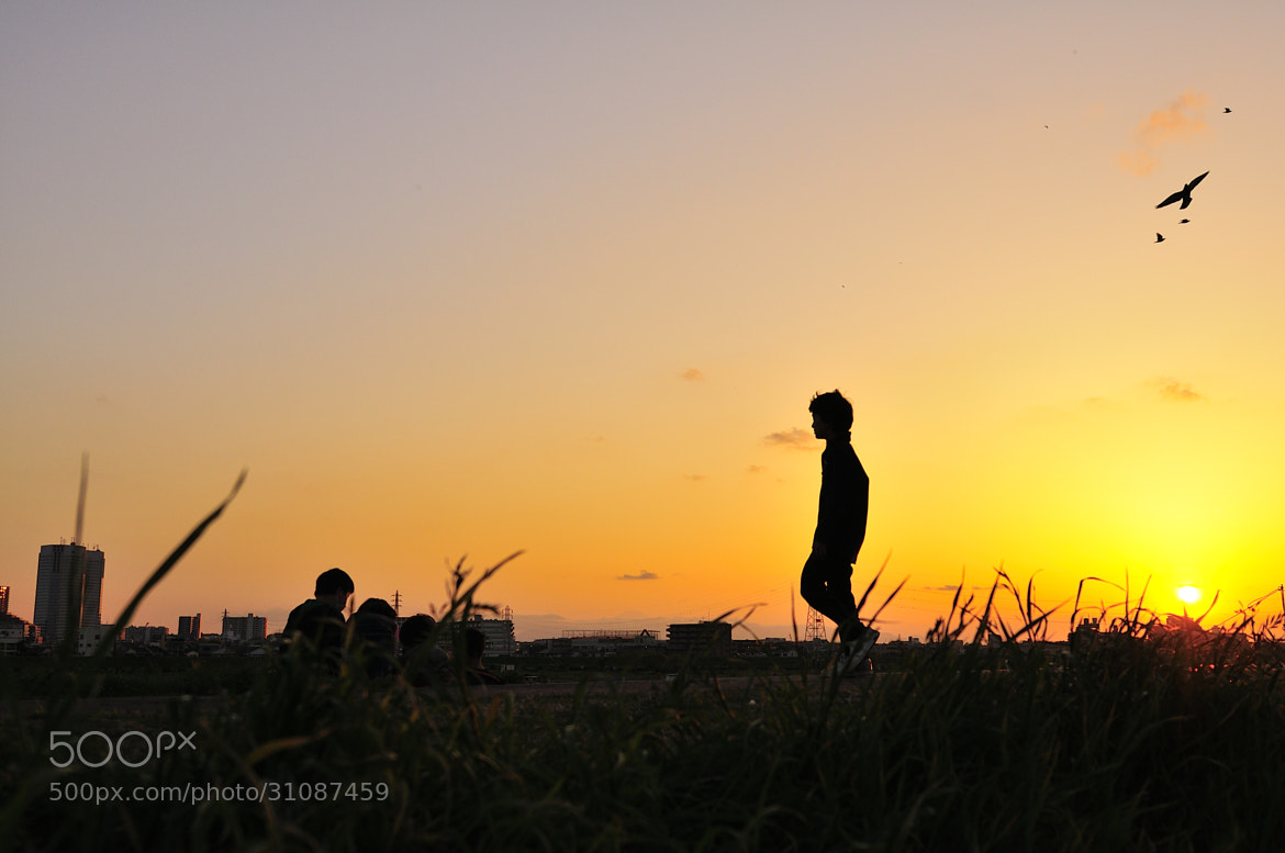 Photograph a boy in the sunset by nao sakaki on 500px
