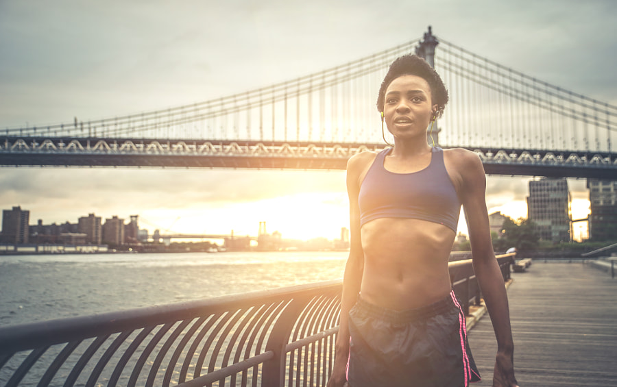 Athlete woman training in the morning at sunrise in New york cit by Cristian Negroni on 500px.com