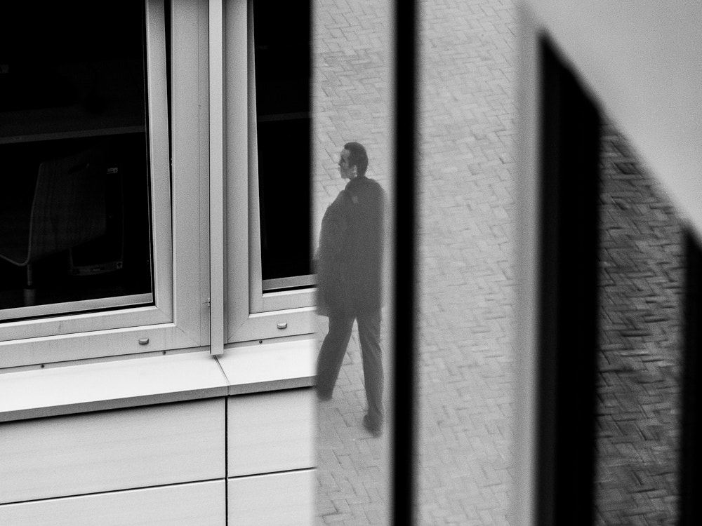 Photograph Man in building window. by Michal Jenčo on 500px
