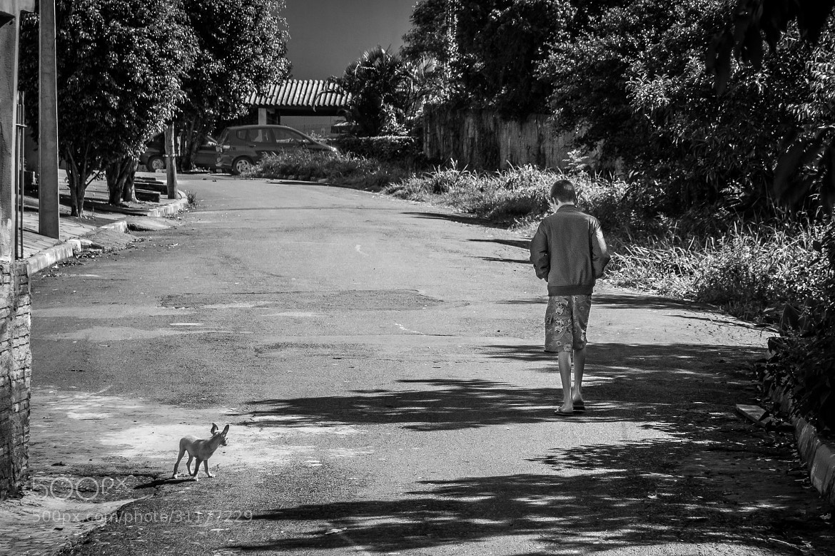 Photograph The kid and his dog by Vanius Roberto Bittencourt on 500px