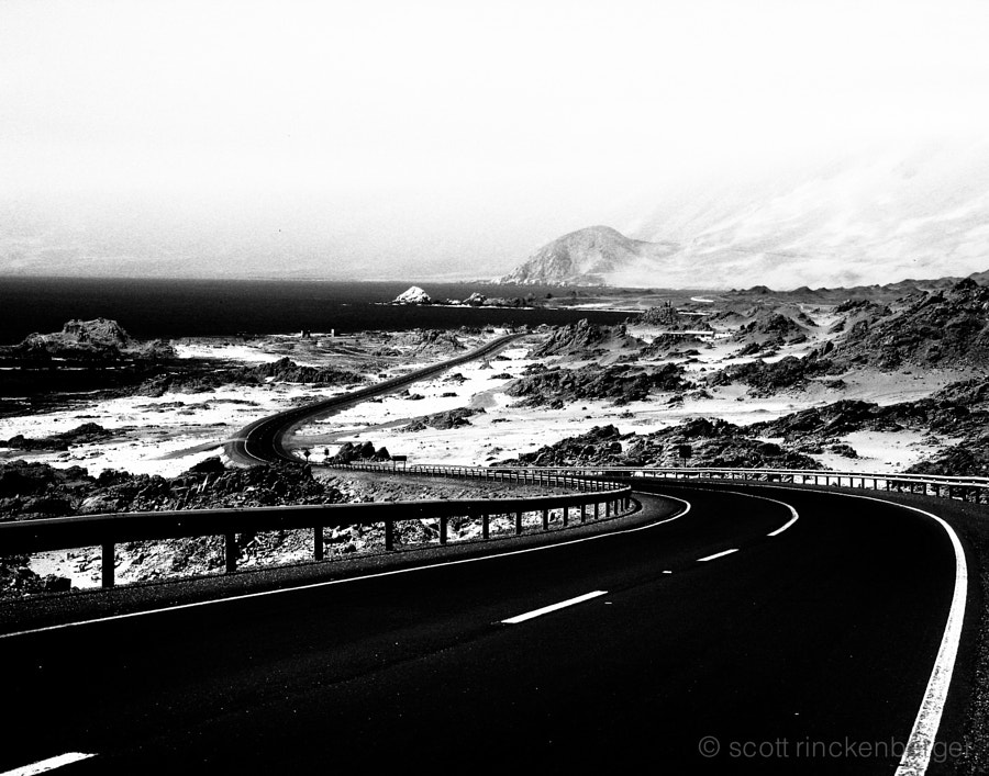This coastal road in Chile was an idyllic scene when I shot this image. Less than an hour later, an 8.0 earthquake with an epicenter less than an fifty miles away completely rocked the landscape, buried the road in both directions and presented me with one of the most nerve racking travel experiences to date.