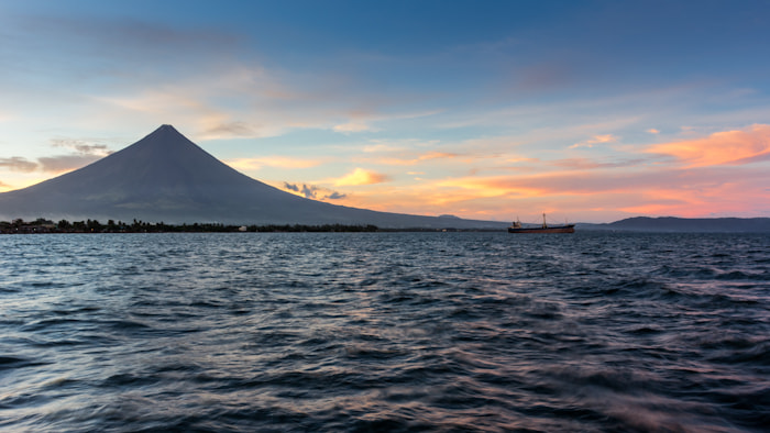 Photograph Sunset on Mt. Mayon and the Albay Gulf by Dave Katz on 500px