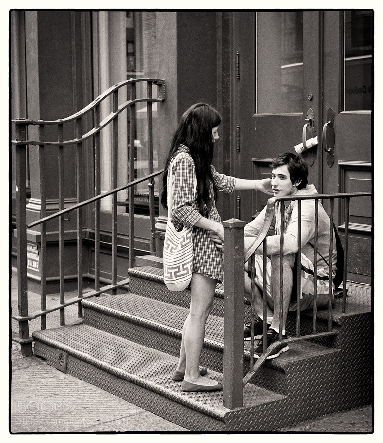 Young couple on the steps of apartment block in New York