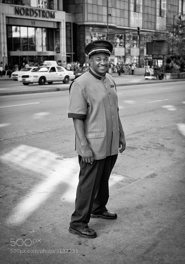 Smiling bellboy outside Chicago hotel