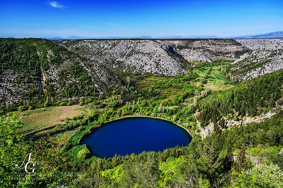 In the canyon of Čikola river in the inner Dalmatia, 47m deep Torak lake is hiding