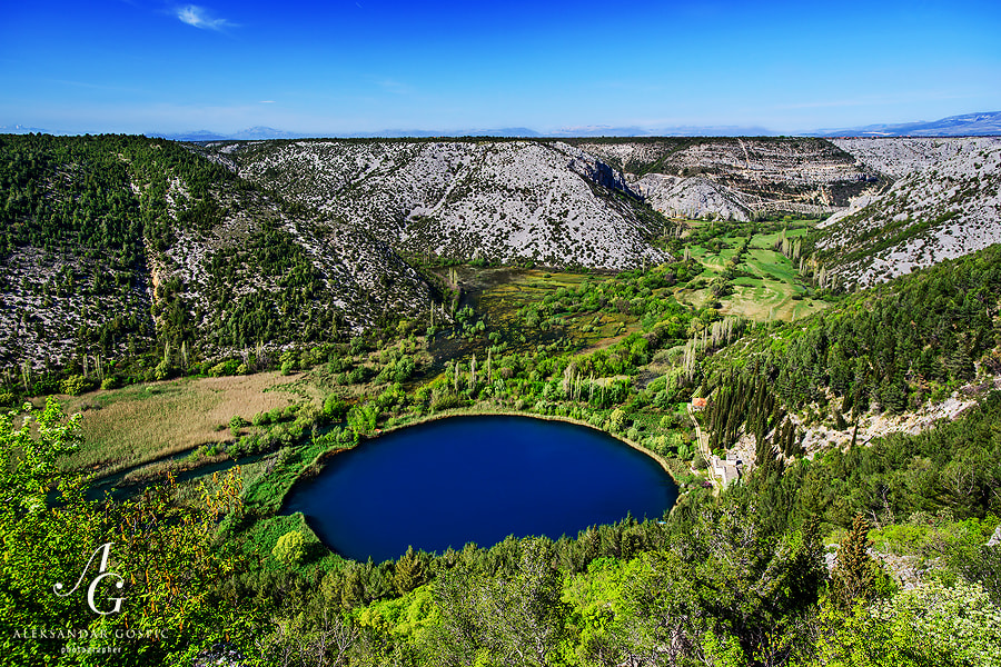 In the canyon of Čikola river in the inner Dalmatia, 47m deep Torak lake is hiding