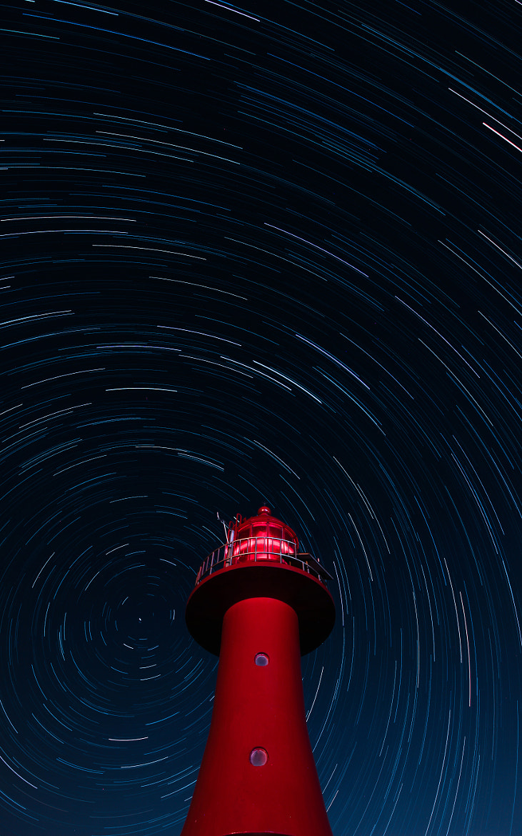 Photograph Startrails with a Lighthouse by Dohyeong Kim on 500px