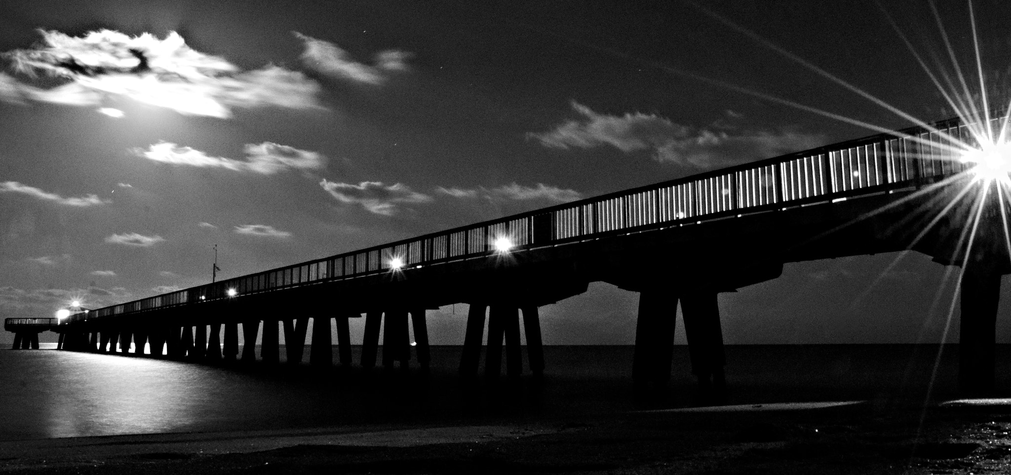 Photograph Moon over pier by Manuel Castillo on 500px
