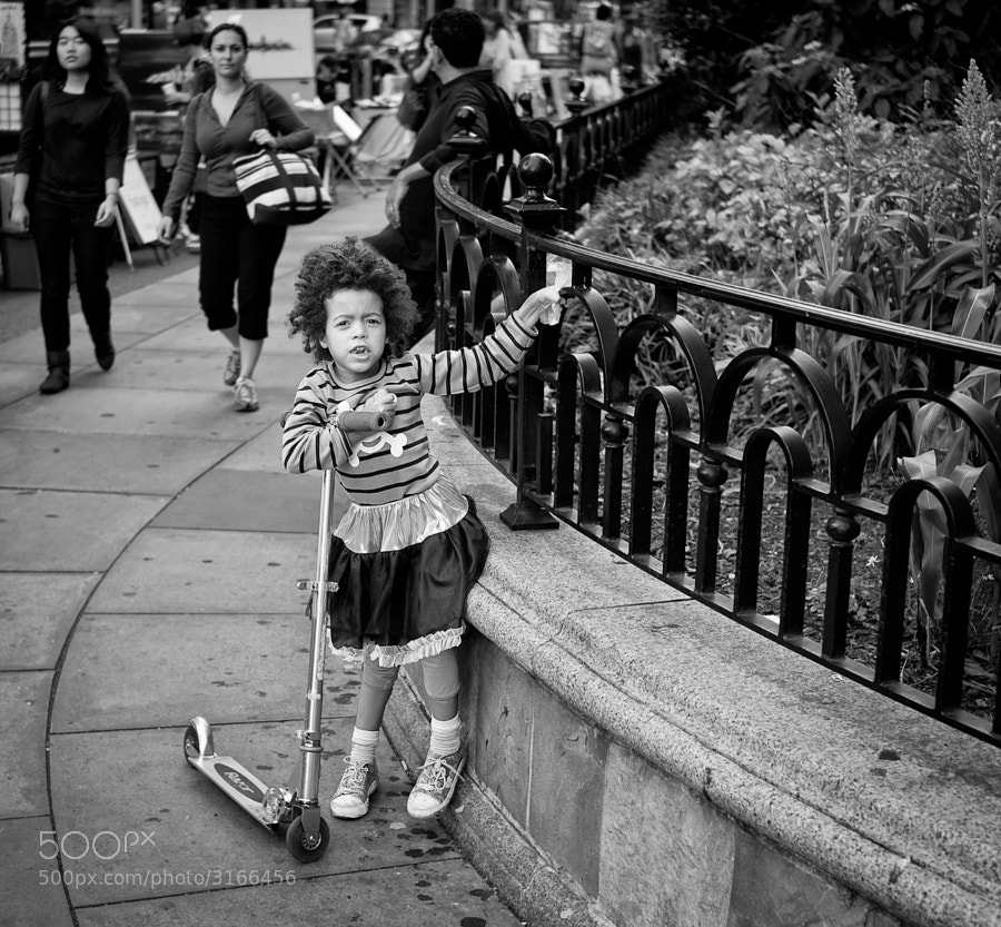 Young girl ready to use her scooter in the park
