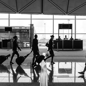 Flight crew heading to their plane in Hong Kong International Airport