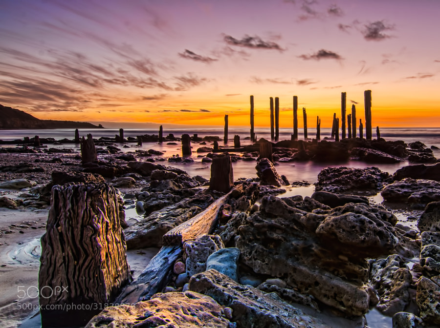 Port Willunga jetty remnants on a colorful evening after sunset