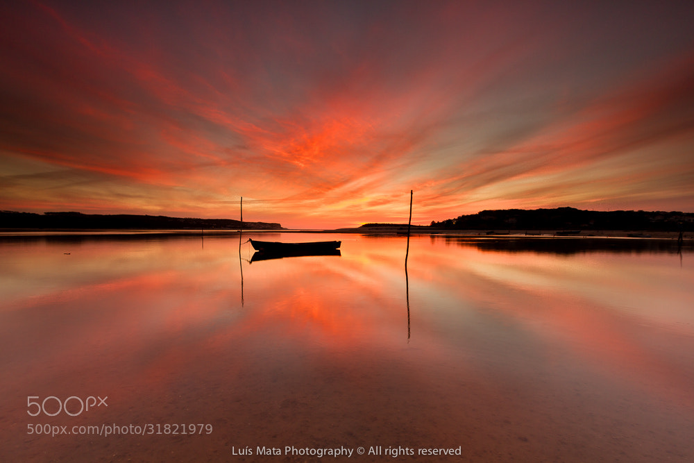 Photograph Sunset reflections by Luis Mata on 500px