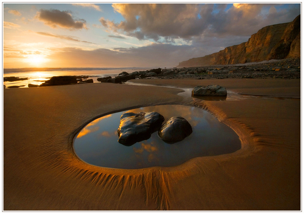 Photograph Rocks in a puddle by Geoffrey Baker on 500px