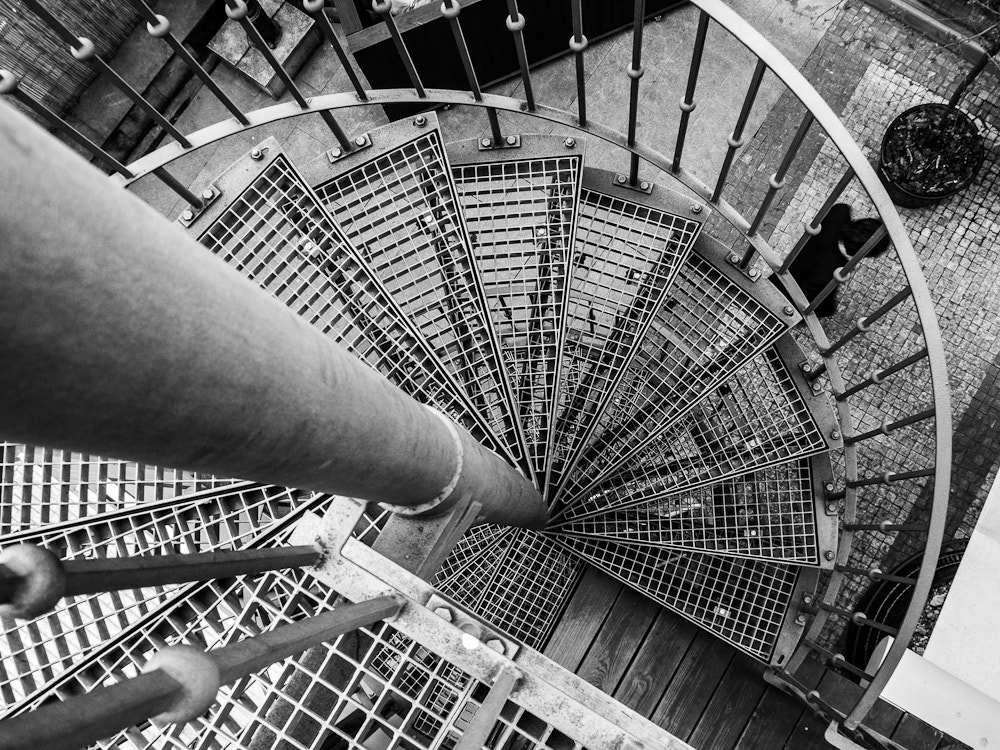 Photograph Man under stairs. by Michal Jenčo on 500px