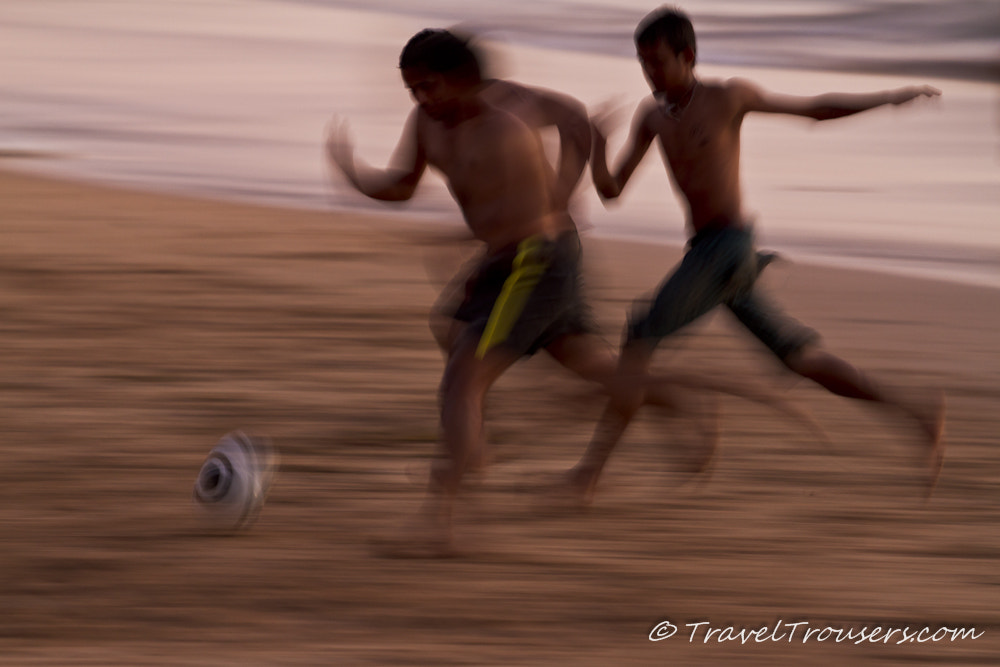 Photograph Group of Indian men chase a football on the beach by Travel Trousers on 500px