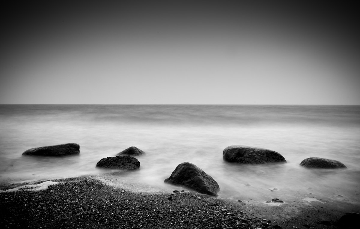 Photograph Stones in the sand by Dela Deden on 500px