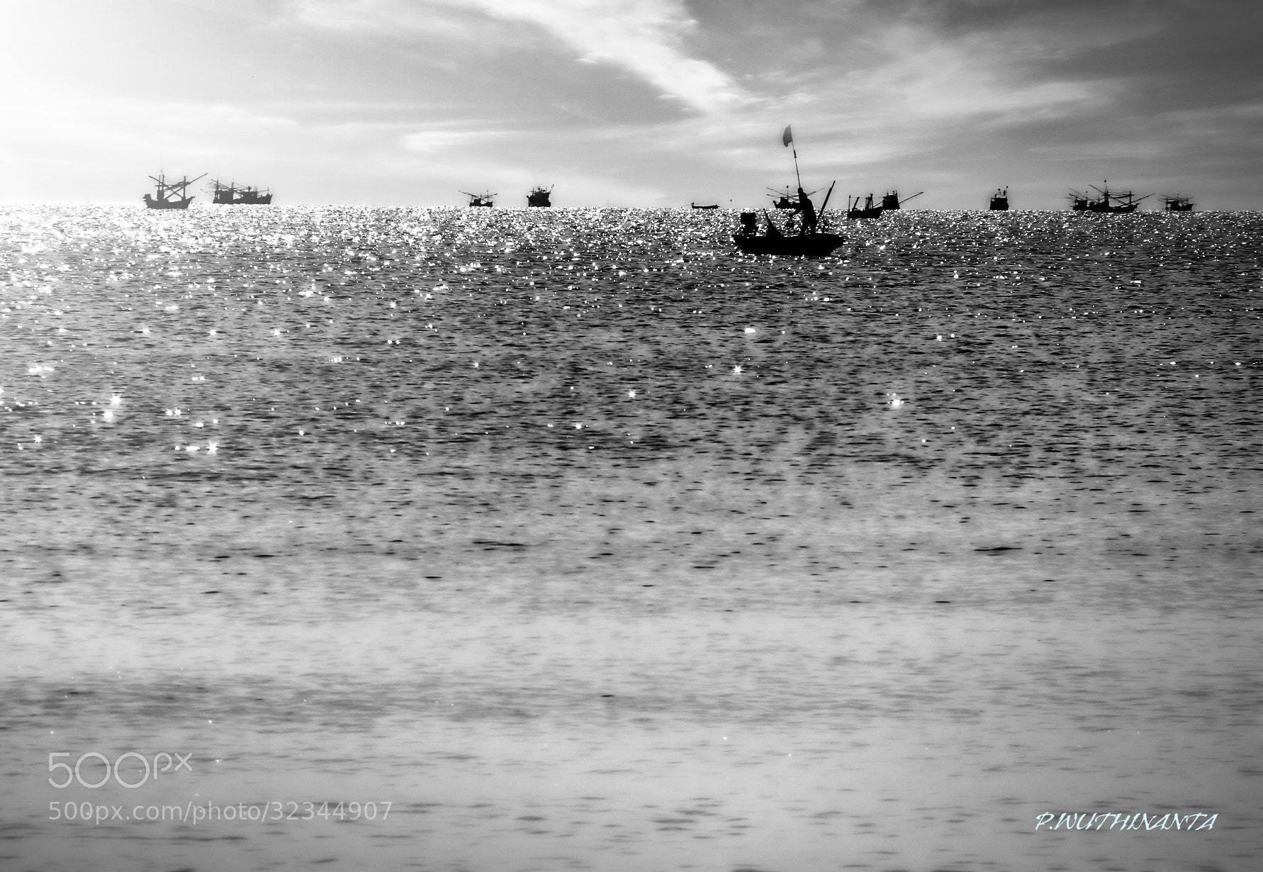 Photograph Fishermen is fishing. by Puthipong Wuthinanta on 500px