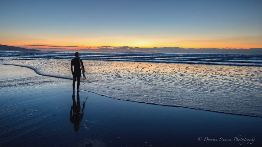 Photograph Surfing the last light by Damien Stenson on 500px