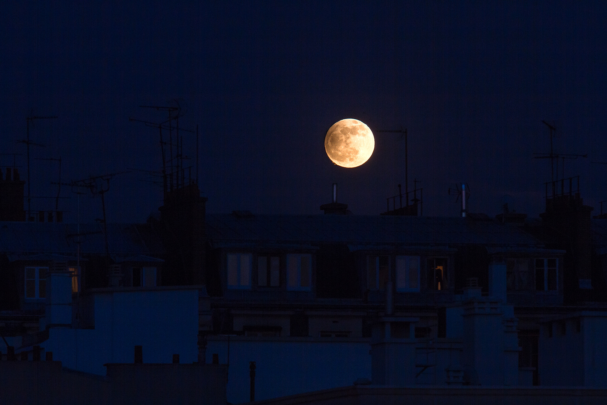 Photograph Partial lunar eclipse of full Moon over the Paris' roofs by Gilles Monney on 500px