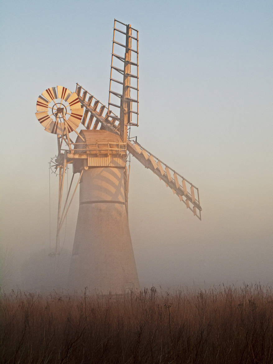 Photograph Early morning fog at Thurne Wind pump by Steve Harrison on 500px