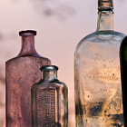 These old bottles, on the sill of a piano window, are never the same hue from sunset to sunset.  Looks more realistic on the click-through.