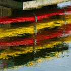 Kayaks, reflected.