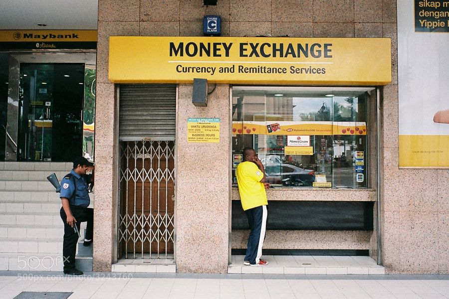 Playing hide and seek in front of money exchange counter?! :)