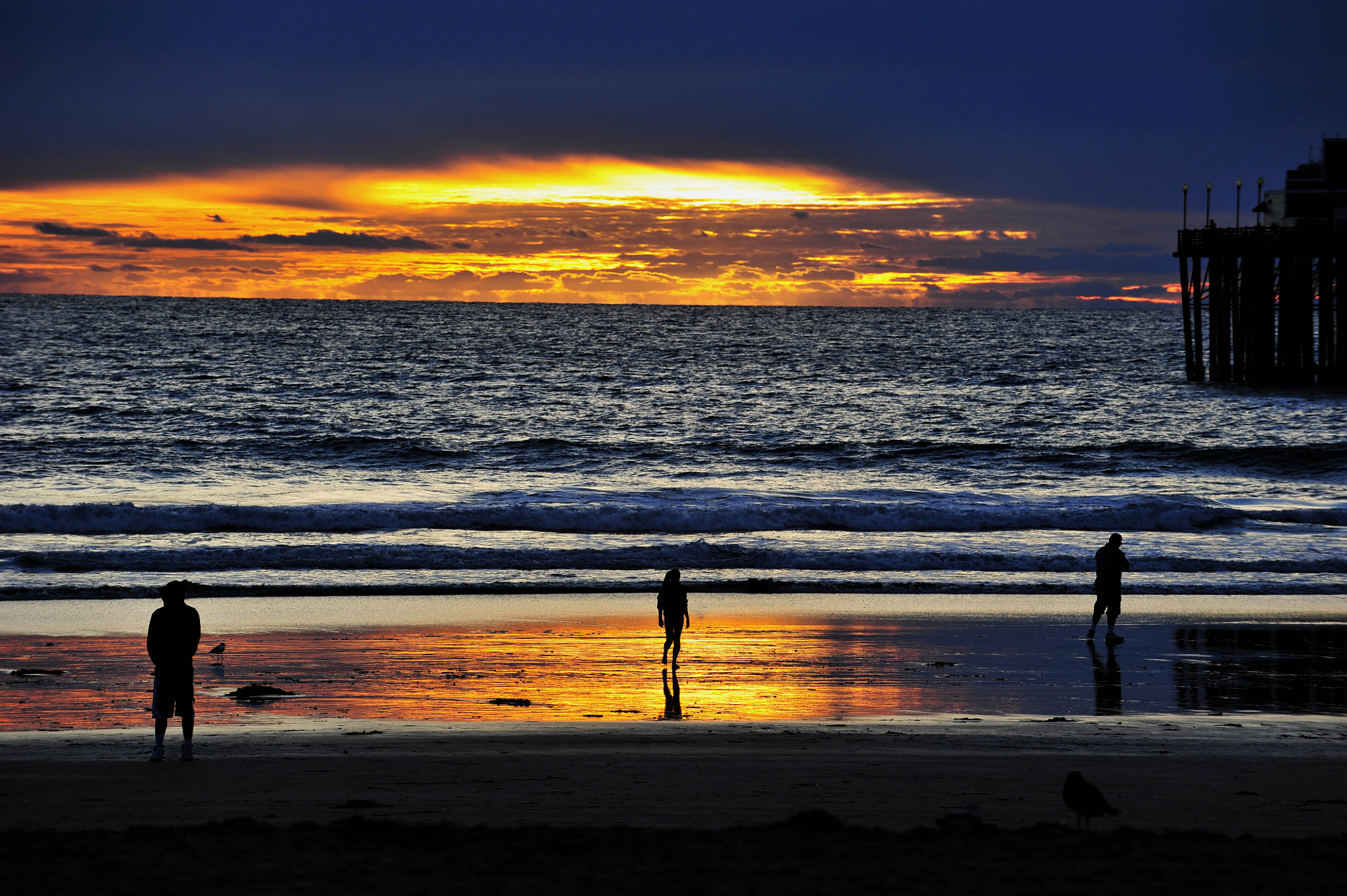 Photograph Three People on the Beach at Sunset in Oceanside. by Rich Cruse on 500px