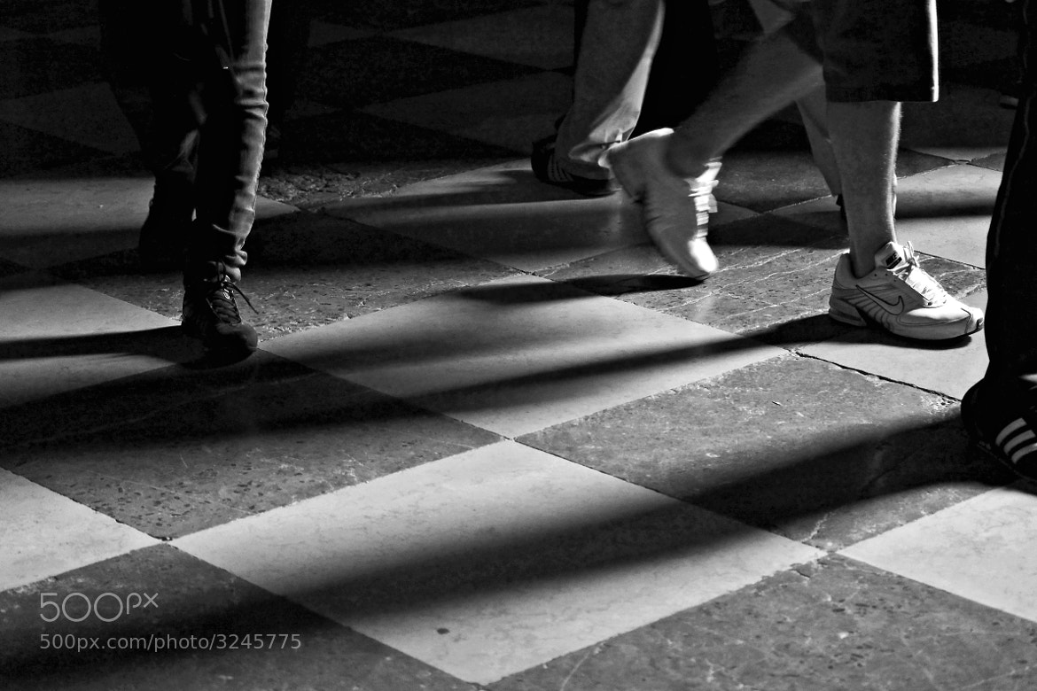 Photograph Movement of pedestrians on the checkerboard of life. by Miguel Silva on 500px