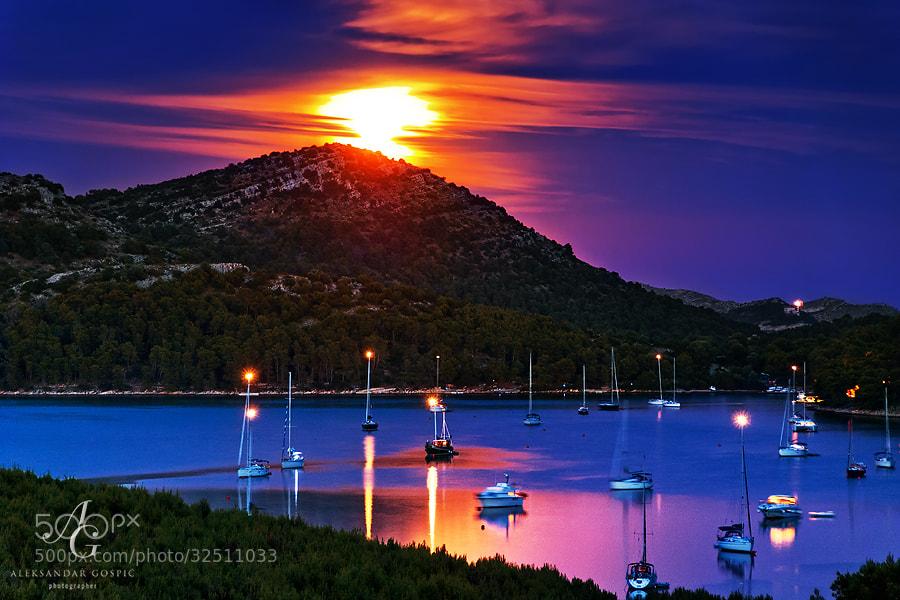 Moon rising through the cirrus clouds above the Telašćica bay on the Dugi Otok island in Zadar archipelago