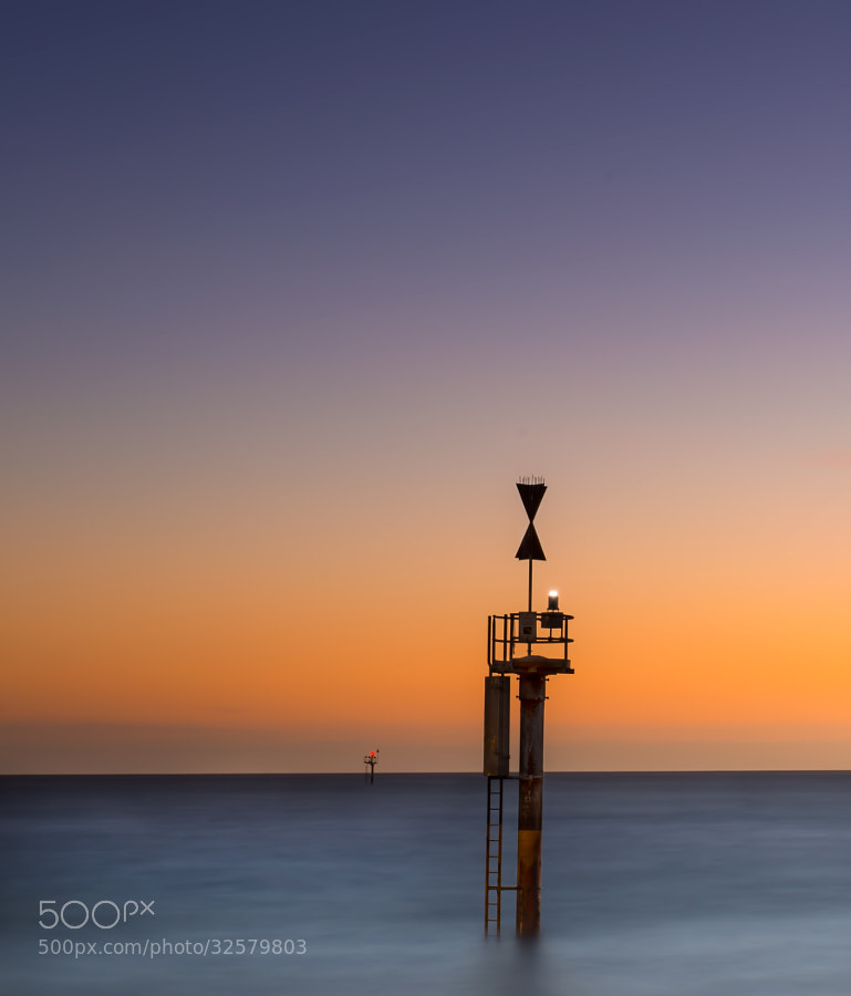 Glenelg is one of the most popular beaches in Adelaide. These  sea lights looked so fantastic to try a minimilistic feel image against the setting sun colors. It was pretty dark and took 155seconds for this exposure.