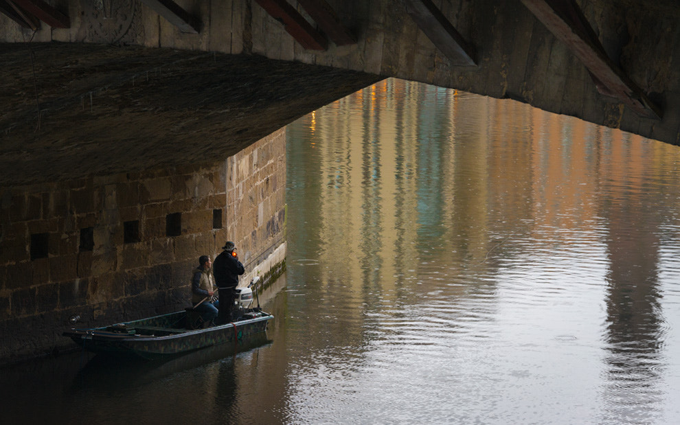 """Photograph Florence. Rain. Fishermen under The Ponte Vecchio (""""Old Bridge"""") on Arno river. by Mike Reyfman on 500px"""
