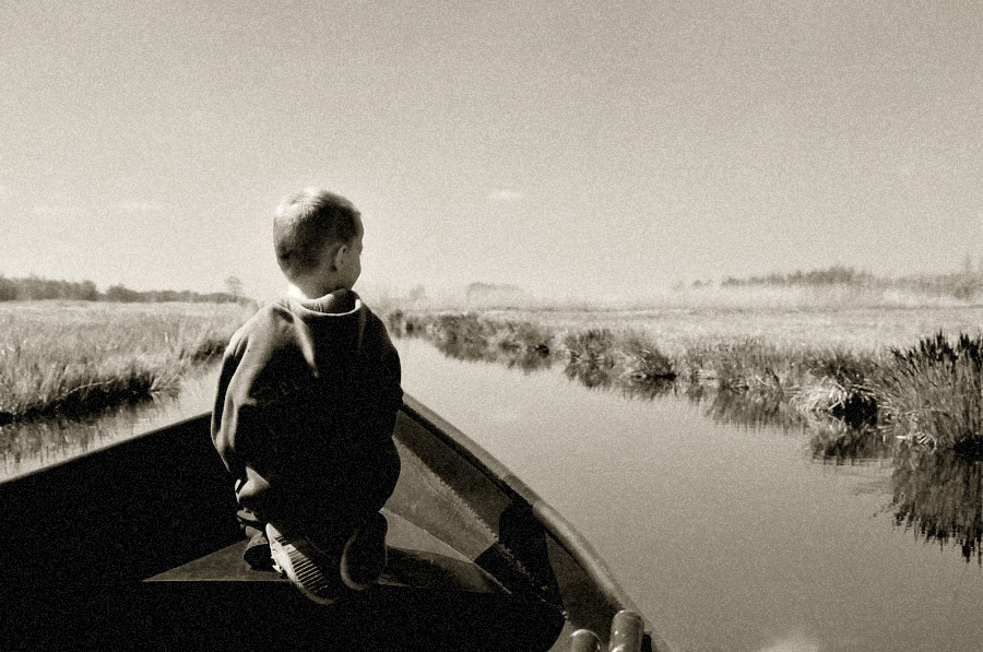 Photograph Little Boy on a Boat by B Timmer on 500px