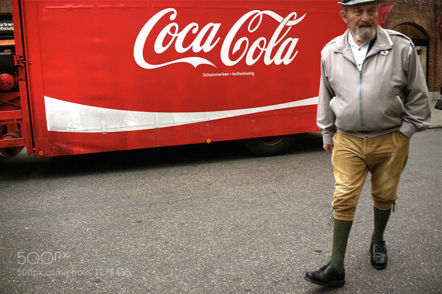 "This man is certainly ""The Real Thing"".  However, ""It's The Real Thing"" is a slogan that was used by Coca-Cola company in the early 70's and pushed forward in a song that always comes to my mind when I see that big red and white logo.