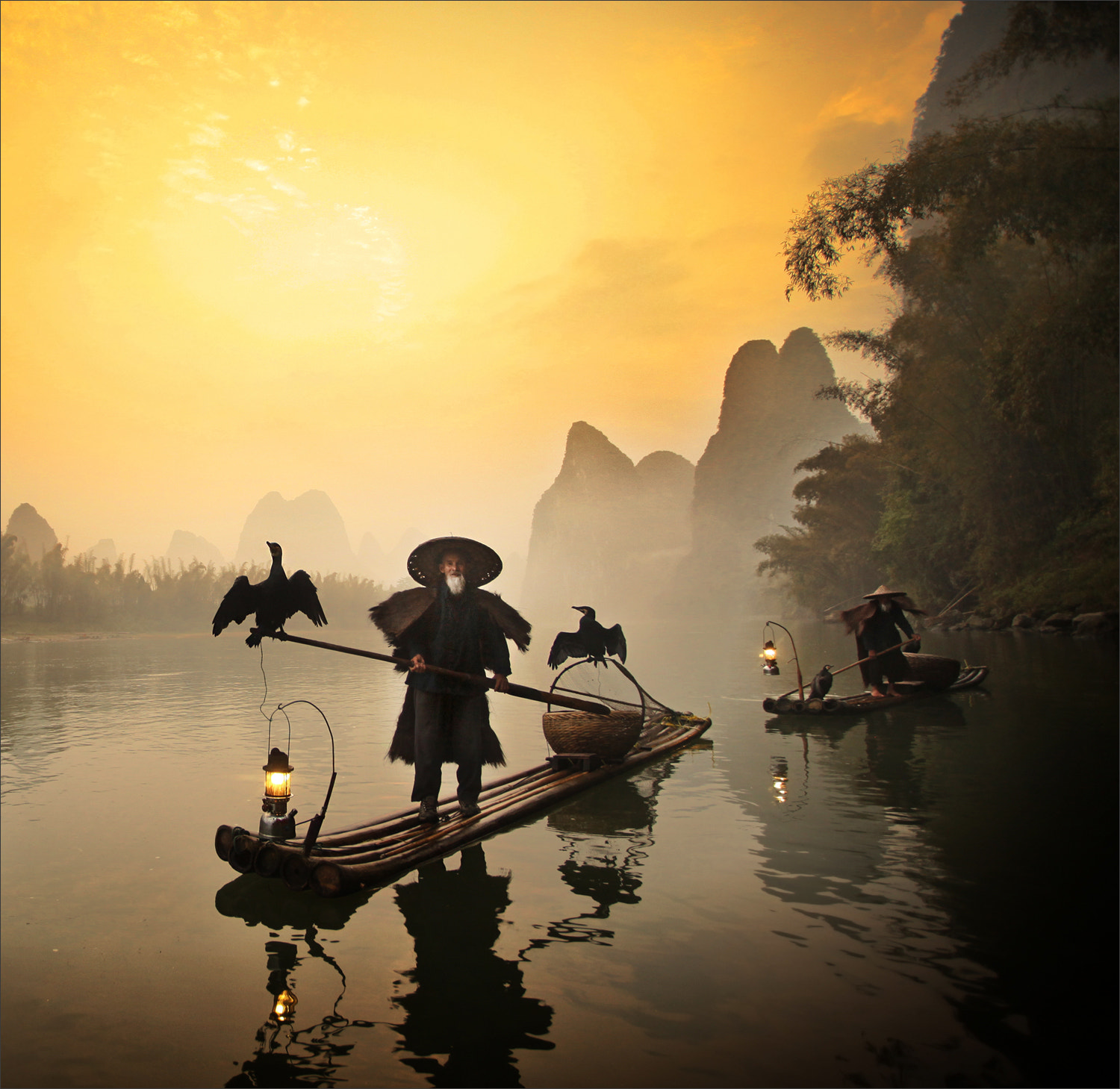 Photograph Cormorants and Old Fisherman, Guilin by Woosra Kim on 500px