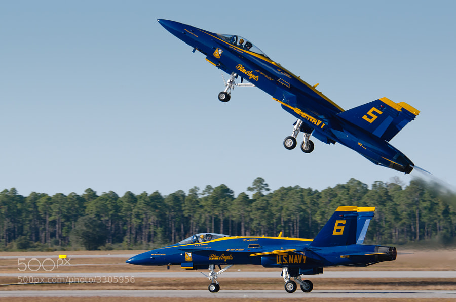 Blue Angels F/A-18 Hornet fighters begin their  flight demonstration at the 2011 NAS Pensacola Homecoming Airshow