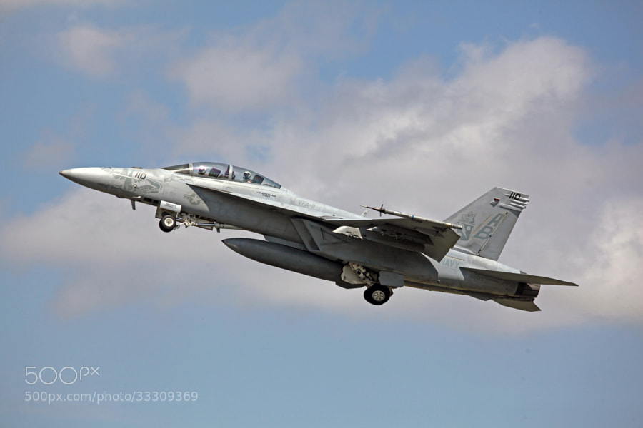 F-18F Super Hornet reaching for the sky after departing 23L.