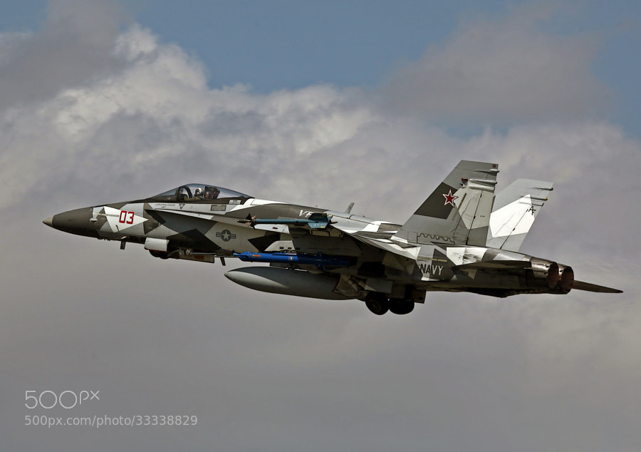 """The USAF has its 'Aggressor' squadrons and the USN uses the term Adversary to describe their ACM or Air Combat Maneuvering Training Squadrons. .  This image depicts one such Adversary, a F-18A+ assigned to VFC-12, the """"Omars."""""""