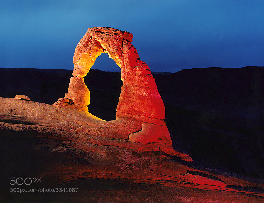 "Delicate Arch, Arches National Park. Night time exposure with three different artifical lights.  Virtually all my NightScapes are ONE exposure (less than 30 seconds), and with very little Photoshop correction. For more how-to and behind the scenes information, visit my <a href=""http://intothenightphoto.blogspot.com/"">Into The Night Photography</a> blog. For Milky Way photography workshops, visit my <a href=""http://intothenightphoto.blogspot.com/2013/11/royce-bairs-2014-photography-workshop.html"">NightScape Events</a> page. You can <a href=""http://roycebair.smugmug.com/Personal-Work/Nightscapes/"">order PRINTS here</a>."