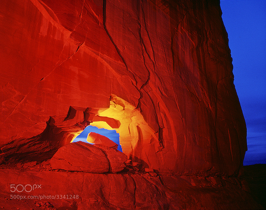 """Hole in the Wall arch - night time exposure with light painting.  Virtually all my NightScapes are ONE exposure (less than 30 seconds), and with very little Photoshop correction. For more how-to and behind the scenes information, visit my <a href=""""http://intothenightphoto.blogspot.com/"""">Into The Night Photography</a> blog. For Milky Way photography workshops, visit my <a href=""""http://intothenightphoto.blogspot.com/2013/11/royce-bairs-2014-photography-workshop.html"""">NightScape Events</a> page. You can <a href=""""http://roycebair.smugmug.com/Personal-Work/Nightscapes/"""">order PRINTS here</a>."""