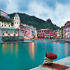 A late Winter storm rolls in over Vernazza in the Cinque Terre region of northern Italy.  A long exposure allowed the camera to capture reflections on the ocean from the village lights.