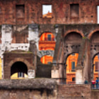 One of the longest lasting and most famouns structures of all time, the Roman Colosseum looms almost too large to be photograhed.  Here, a small section of this prolific ruin is used to frame the color of surrounding buildings.