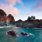 McWay Falls spills onto the Beach at Julia Pfeiffer Burns State Park as the sun does it's best to paint a pastel goodnight to the trees and sky.