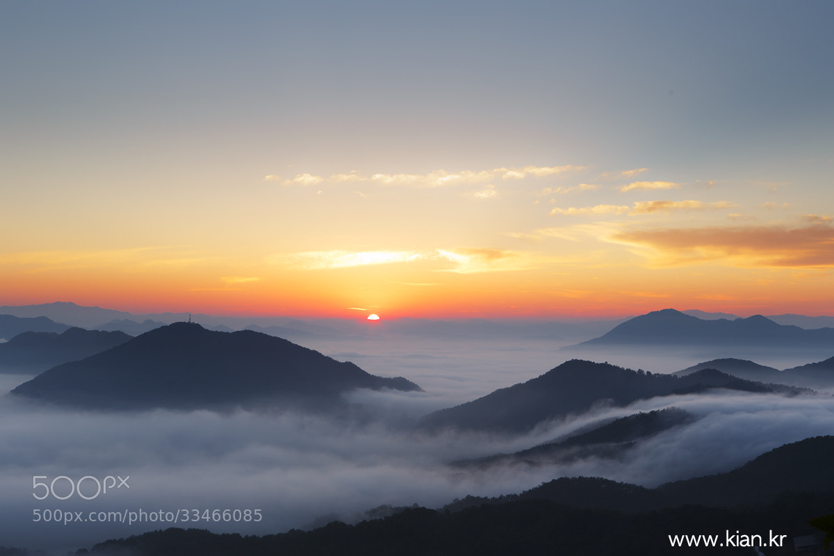 Photograph Sunrise over cloud by Suk Bae on 500px