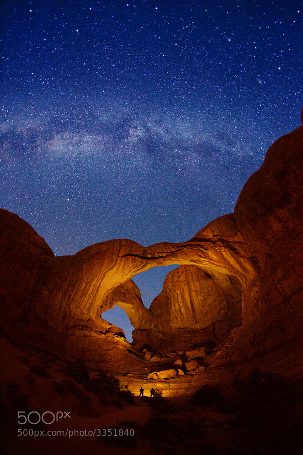 """Light painting on this arch was assisted by my two new friends, Allen and Craig, from Texas (standing at the bottom of of Double Arch). This northwestern view of the arch and the night sky was captured with a 30-second exposure.  Virtually all my NightScapes are ONE exposure (less than 30 seconds), and with very little Photoshop correction. For more how-to and behind the scenes information, visit my <a href=""""http://intothenightphoto.blogspot.com/"""">Into The Night Photography</a> blog. For Milky Way photography workshops, visit my <a href=""""http://intothenightphoto.blogspot.com/2013/11/royce-bairs-2014-photography-workshop.html"""">NightScape Events</a> page. You can <a href=""""http://roycebair.smugmug.com/Personal-Work/Nightscapes/"""">order PRINTS here</a>."""