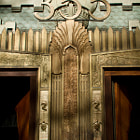 """Morning light on the Art Deco entrance to the Marine Building, at 355 Burrard Street, Vancouver, Canada.  Designed by McCarter Nairne and Partners and built in 1939, the Marine Building is renowned for its Art Deco details.  According to the architects, the building was intended to evoke """"some great crag rising from the sea, clinging with sea flora and fauna, tinted in sea-green, touched with gold."""""""