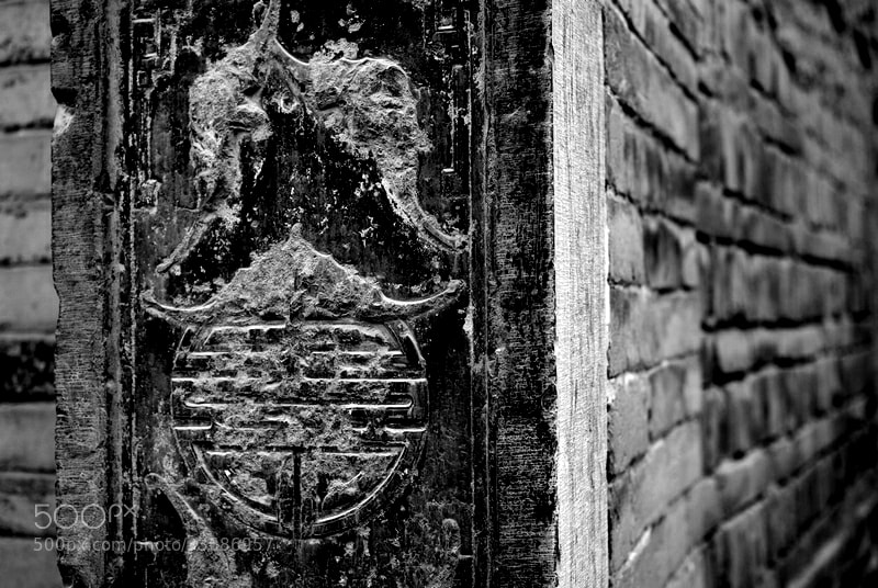 Photograph Stone carving and brick wall by Wei Feng on 500px